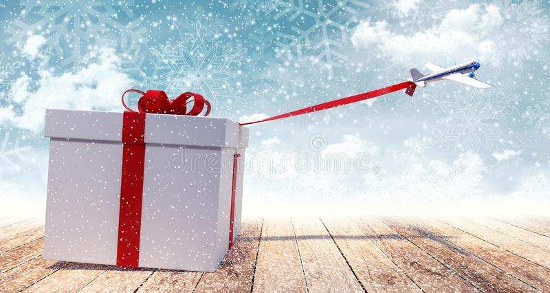 Airplane toy pulling huge white Christmas present royalty free stock photo