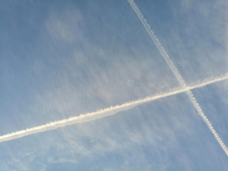 airplane trails stock photos