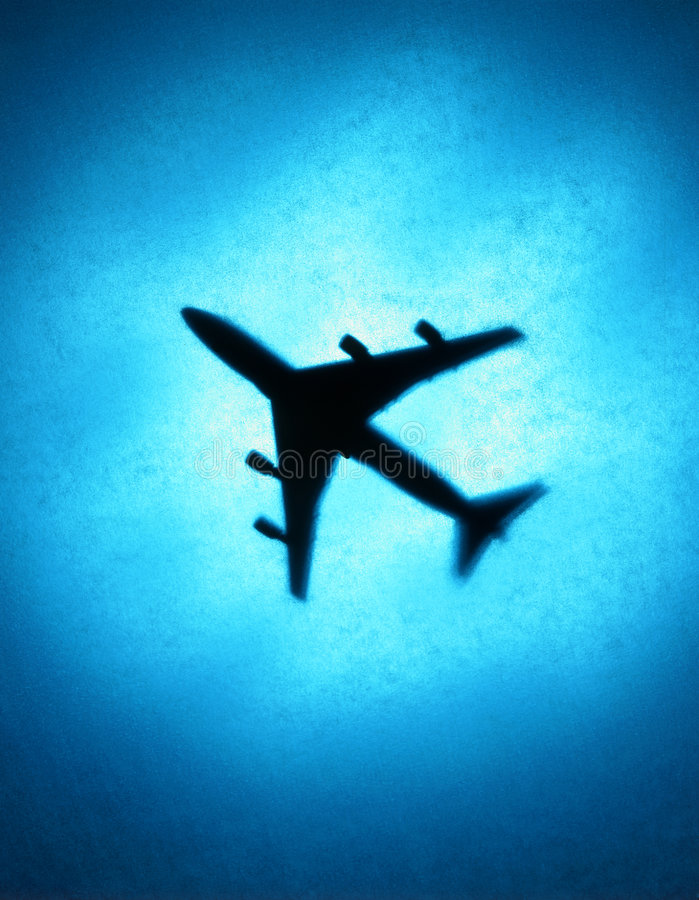 Airplane Travel Blue Sky Silhouette. Aeroplane flying in a blue cloudy sky royalty free stock photos