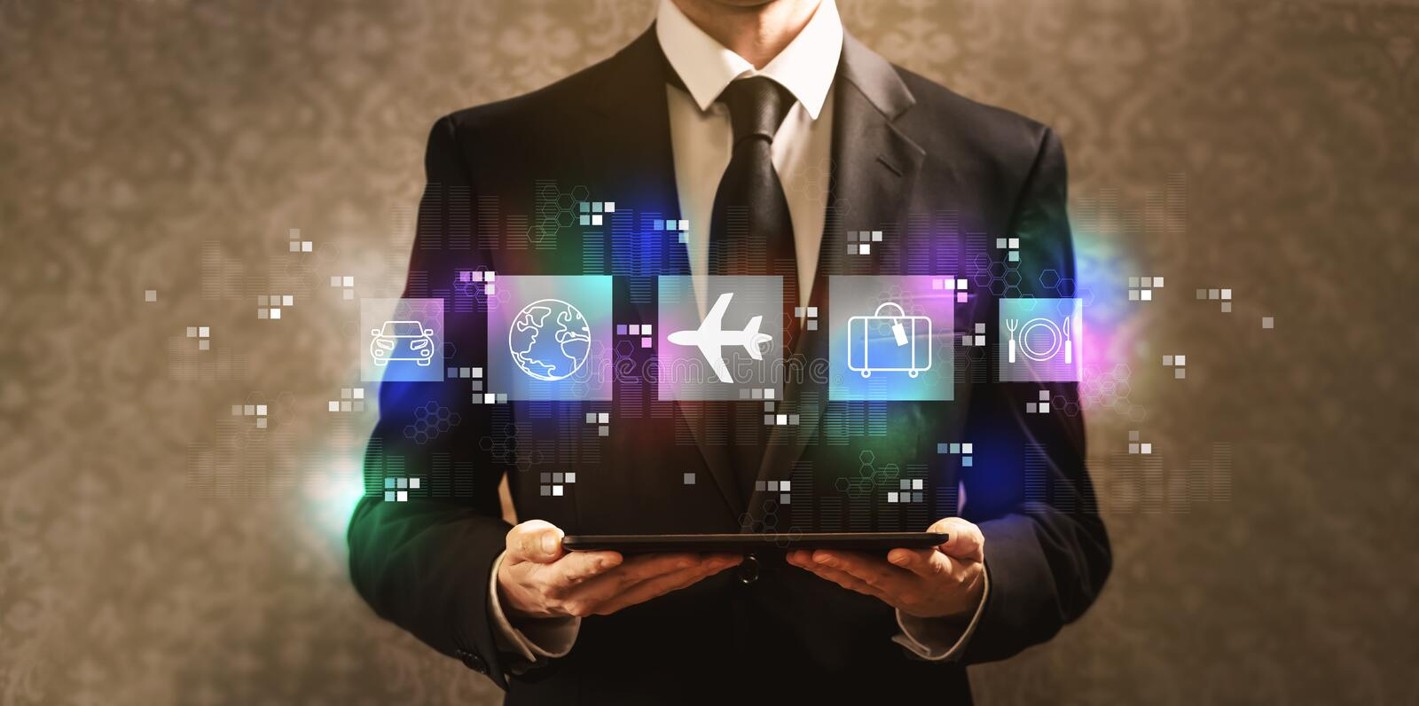 Airplane travel theme with businessman holding a tablet computer royalty free stock photography