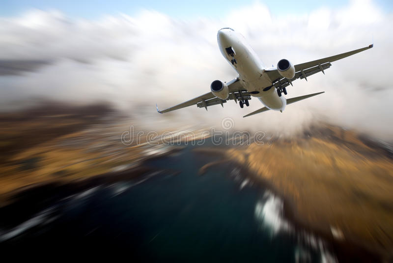 Airplane traveling royalty free stock photography