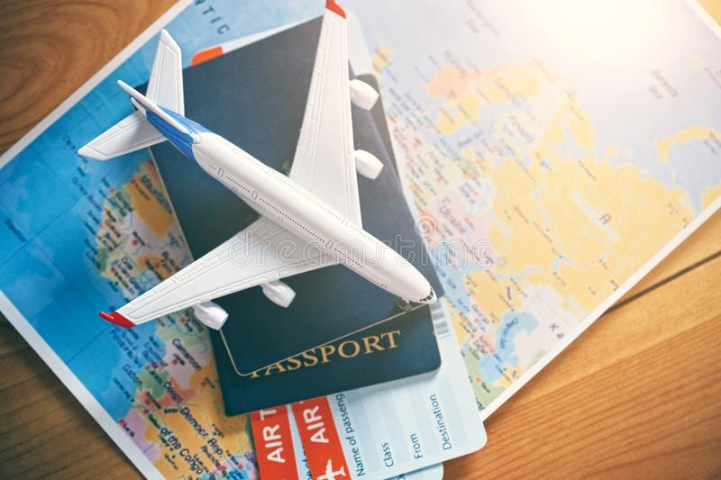 Airplane traveling and tickets booking concept. Plane model with world map, passports and tickets as airplane traveling and tickets booking concept royalty free stock photography