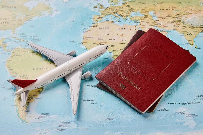 Airplane and two passports travel documents stock image