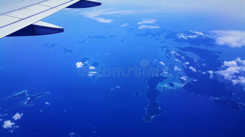 Airplane view of blue sea and blue sky stock images