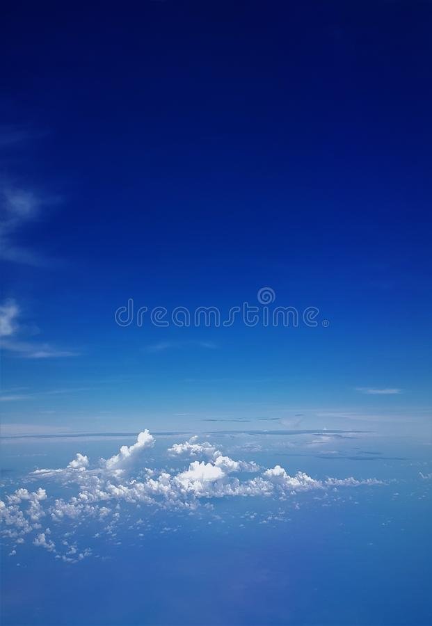 Airplane view of blue sea and blue sky stock image