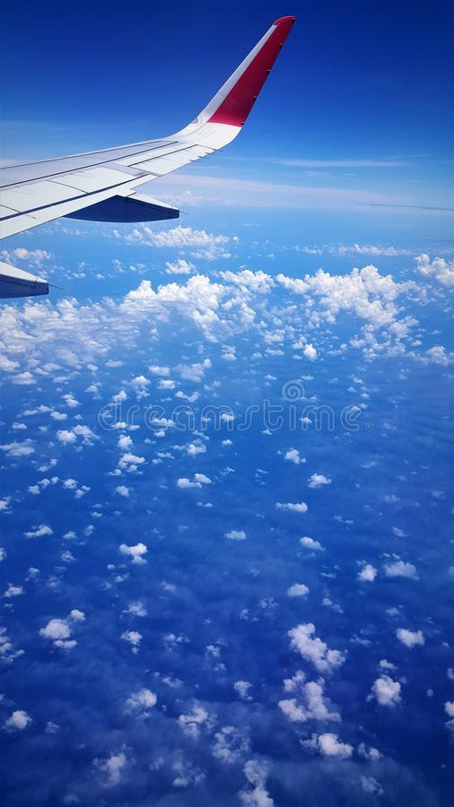 Airplane view of blue sea and blue sky royalty free stock images