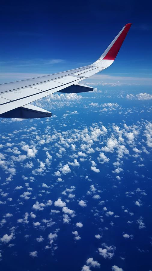 Airplane view of blue sea and blue sky royalty free stock photos