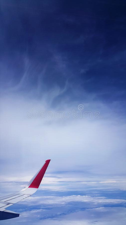 Airplane view of blue sea and blue sky royalty free stock image
