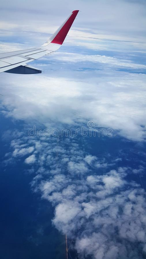 Airplane view of blue sea and blue sky royalty free stock photography
