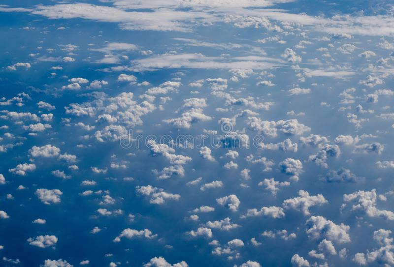 Airplane view to Altocumulus clouds and shadows of them above sea surface. Airplane view to Altocumulus and shadows of them above sea surface stock photography