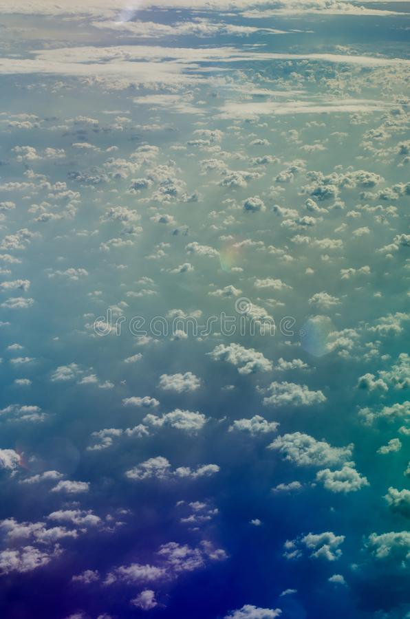 Airplane view to Altocumulus clouds and shadows of them above sea surface. Airplane view to Altocumulus and shadows of them above sea surface stock photos
