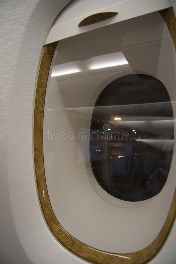 Airplane window at the night flight royalty free stock photography
