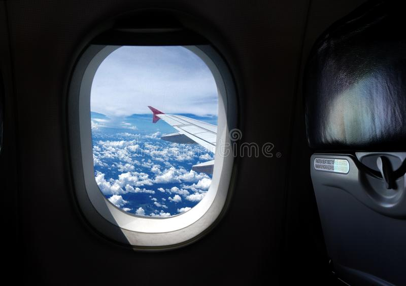 Airplane window seat with view. Image of airplane window seat with wing view stock image