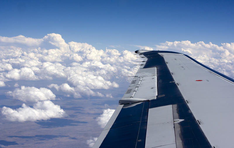 Airplane Wing Above The Clouds Stock Image - Image of ...