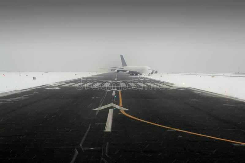 Airplane wing aircraft landing in snow stock photos