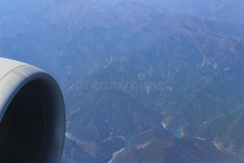 airplane wing aircraft turbine flying blue sky white clouds stock photo
