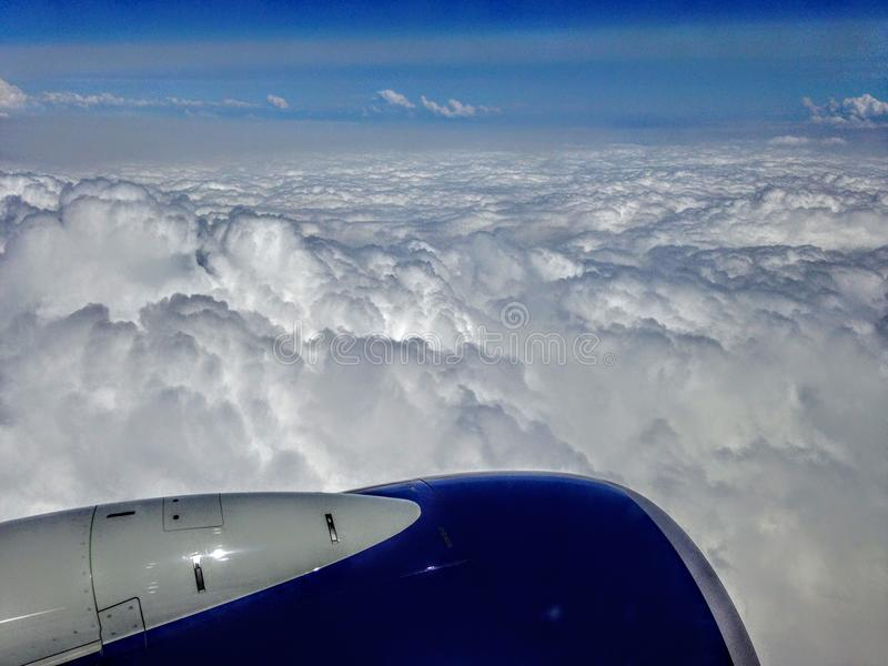 Airplane wing aircraft turbine flying blue sky white clouds royalty free stock image