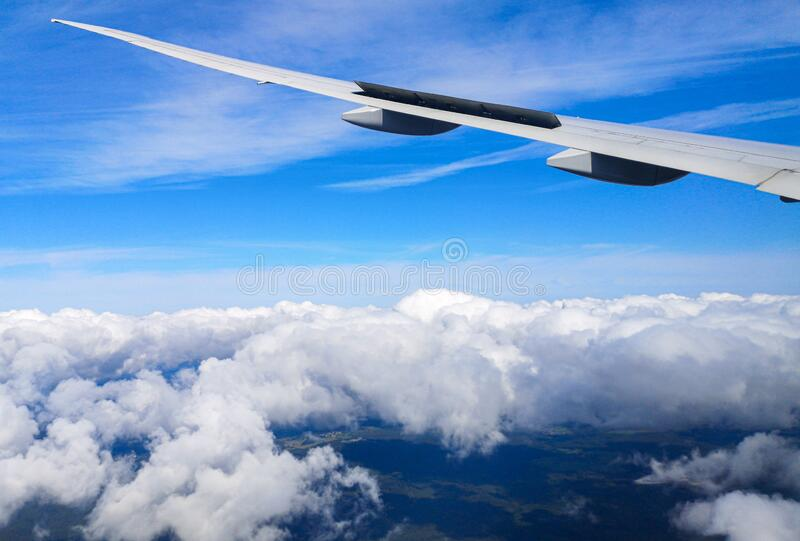 Airplane wing in flight. View from the porthole stock photo
