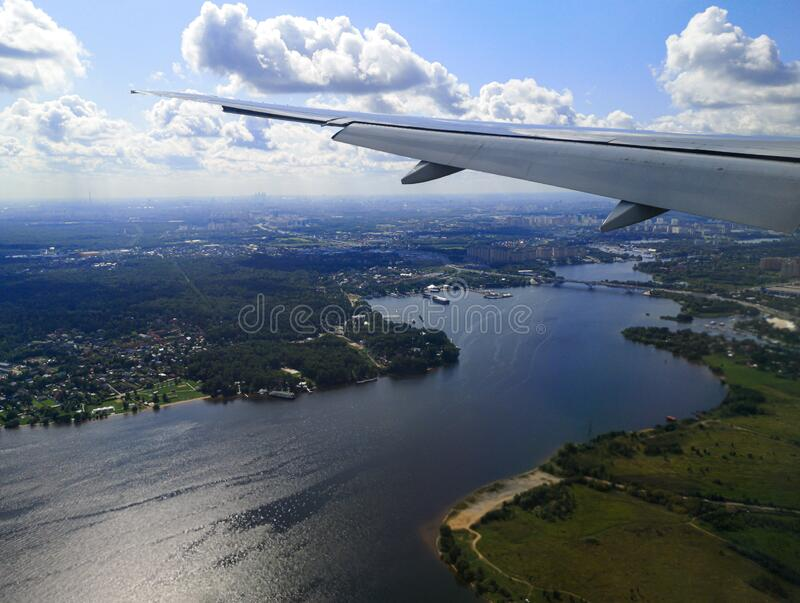 Airplane wing in flight. View from the porthole royalty free stock photography