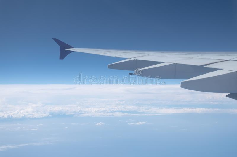 Airplane Wing in Flight from window stock photos