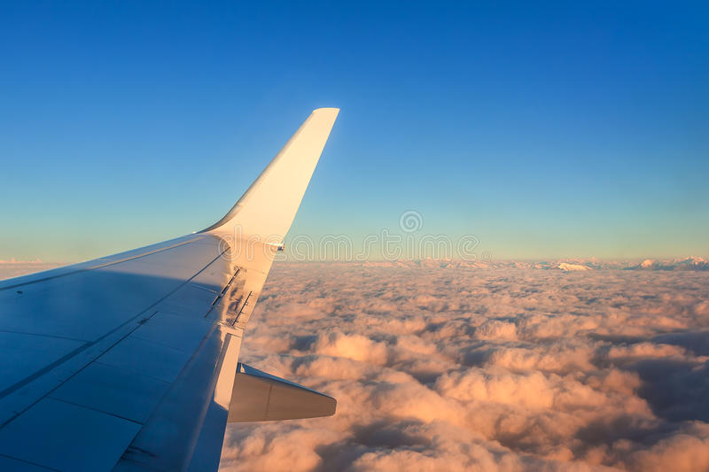 Airplane wing over clouds. royalty free stock photos