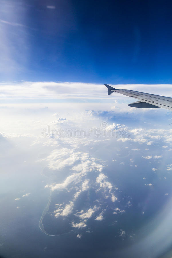 Download Airplane Wing Over Indian Ocean Stock Image - Image of daylight, wing: 75986375