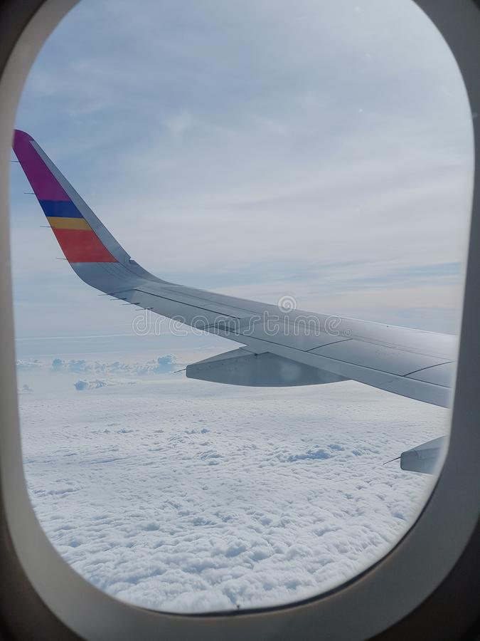 Airplane wing on the sky stock photos