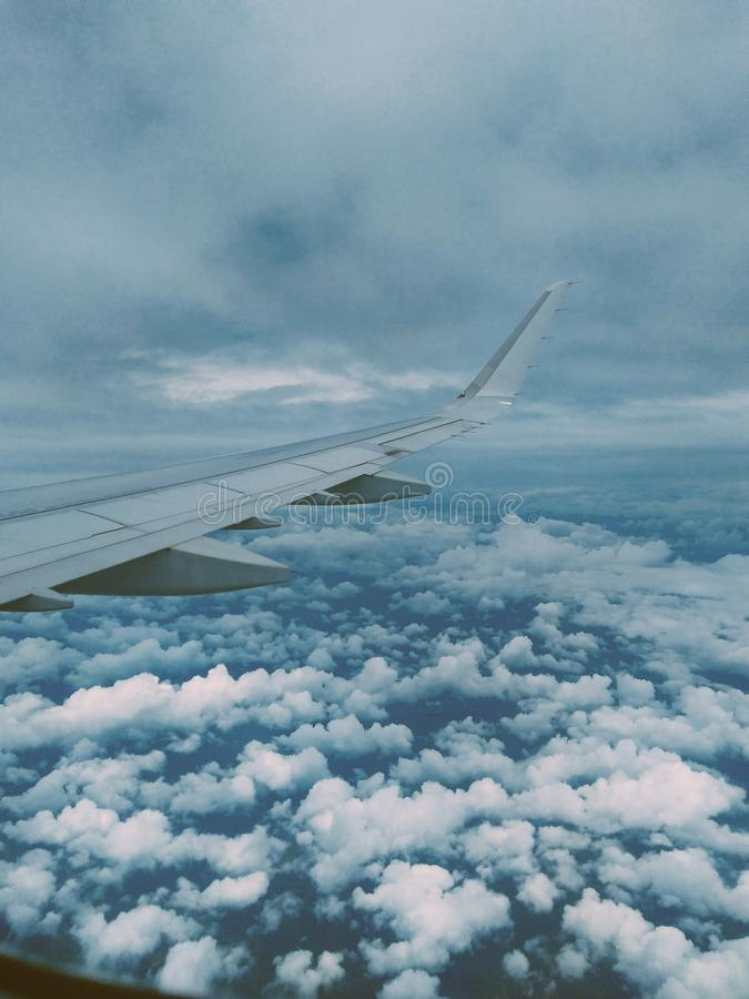 Airplane Wing and Thick Clouds royalty free stock images
