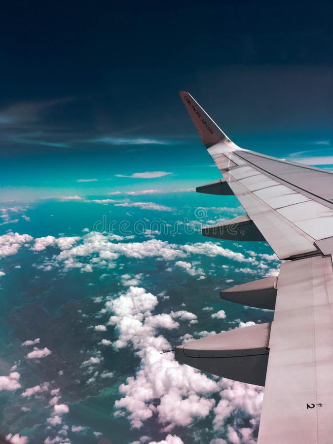Airplane Wing Towards Clouds royalty free stock photos