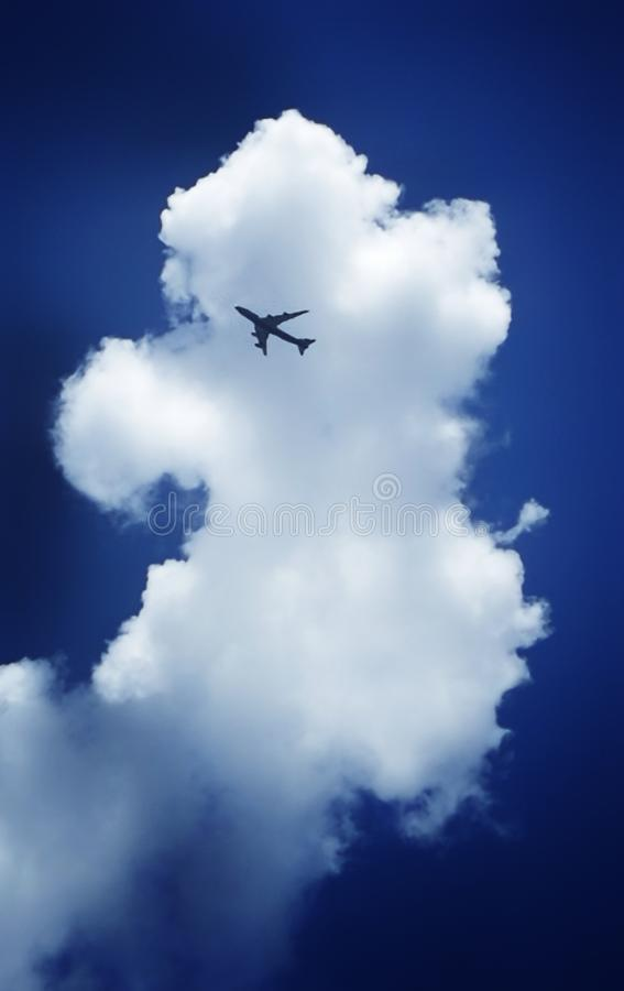 Free Airplane With The Background Of Clouds And Blue Sky Stock Images - 103289554