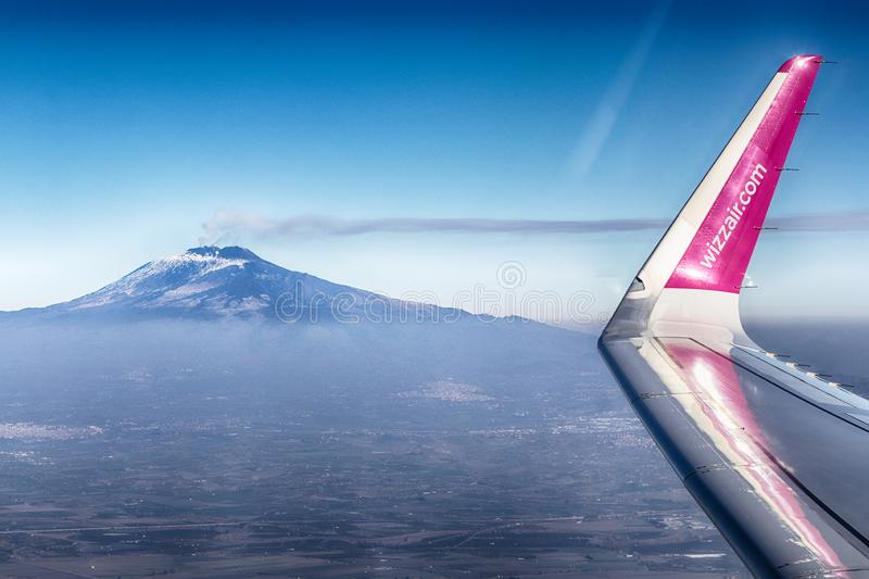 Airplane of the airline Wizzair flies over the skies of Sicily stock images
