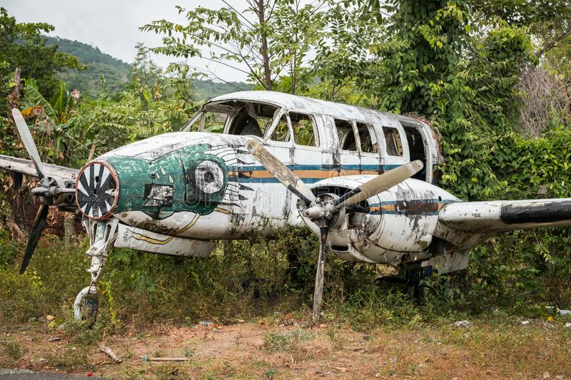 Airplane wreckage in jungle - old propeller aircraft in forest stock photos