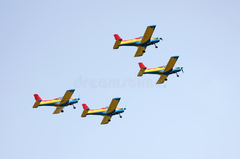 Airplanes at the air show. Four planes up in the air at the show stock photos