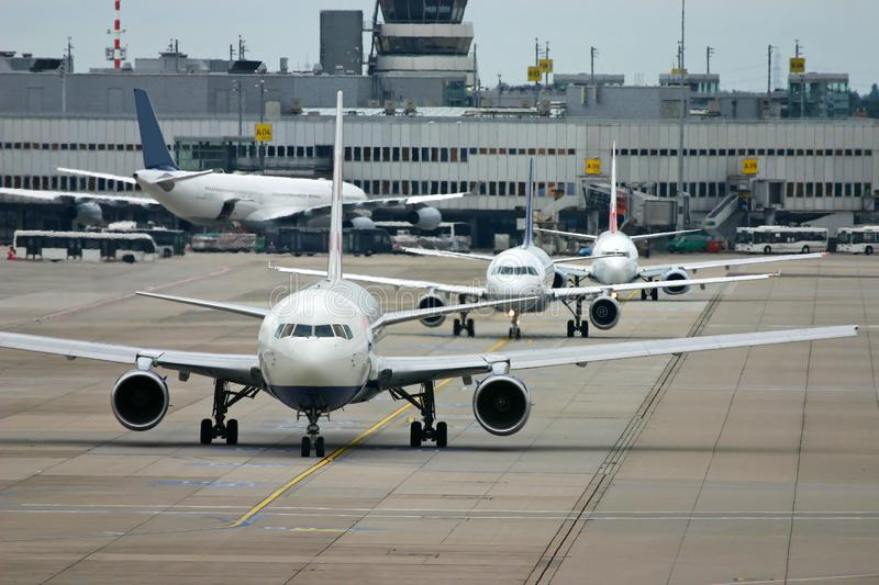 Airplanes on airport royalty free stock photography