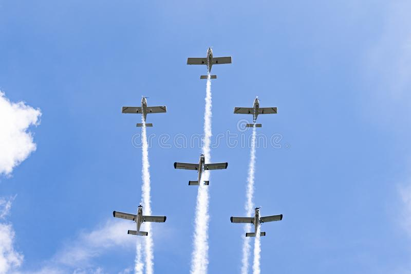 Airplanes on airshow. Aerobatic team performs flight at air show in Krakow, Poland. stock image