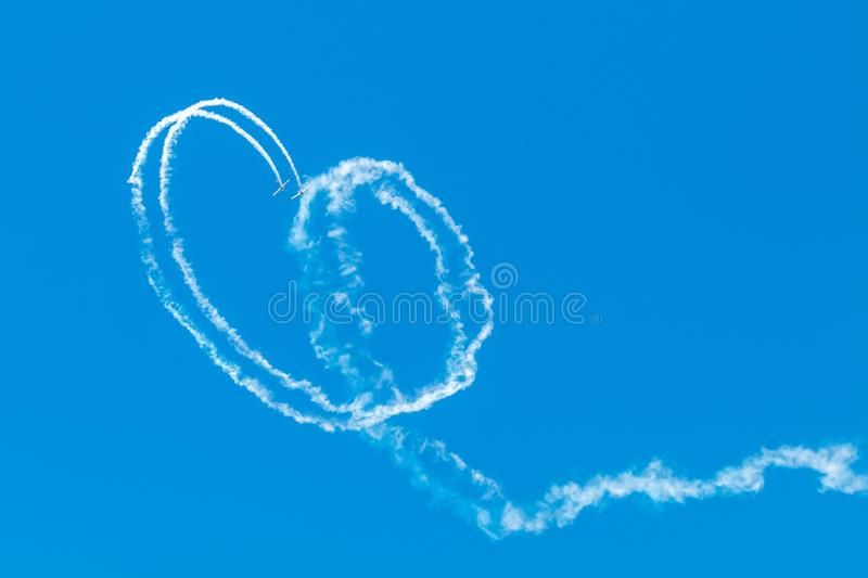 Airplanes on airshow. Aerobatic team performs flight at air show. Portugal air summit royalty free stock image
