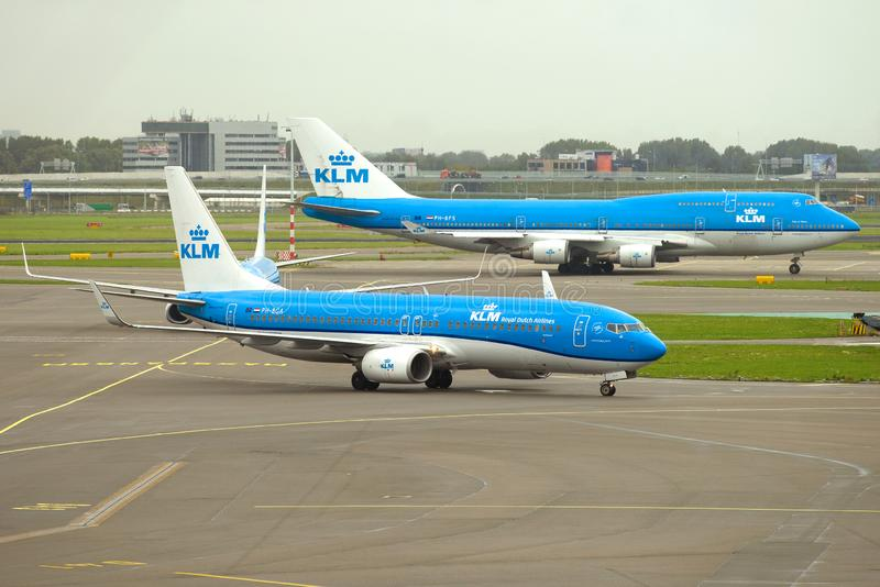 Airplanes Boeing 737-800 PH-BGA and Boeing 747-400M PH-BFS of KLM Royal Dutch Airlines. AMSTERDAM, THE NETHERLANDS - SEPTEMBER 30, 2017: Airplanes Boeing 737-800 royalty free stock photography