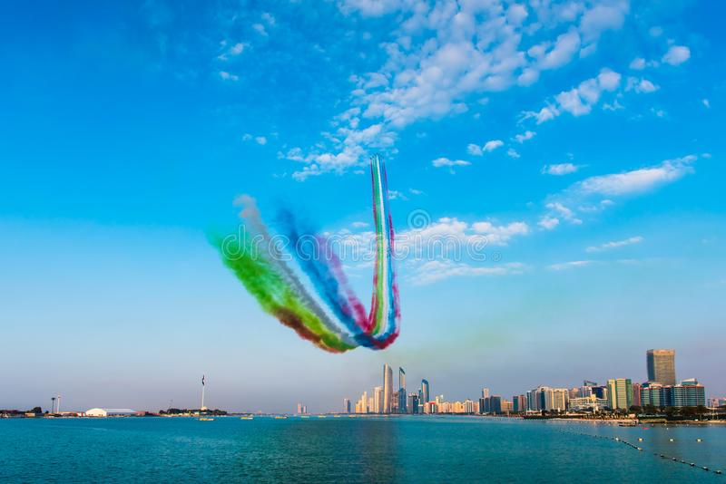Airplanes flying above Abu Dhabi skyline for the UAE national day celebration airshow. Airplanes flying above Abu Dhabi skyline for the UAE national day stock photos