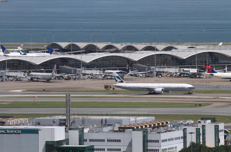 Airplanes at Hong Kong airport runway stock images