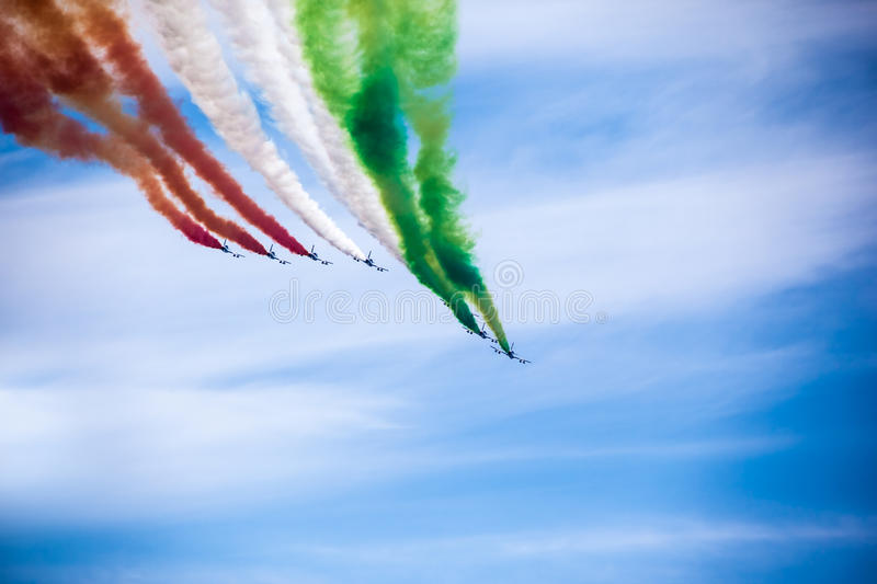 Airplanes. The italian acrobatic jet squad named frecce tricolori doing tricks in the sky royalty free stock photography