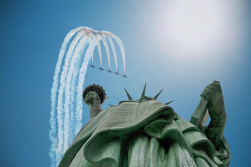 Airplanes over Statue of Liberty stock photos
