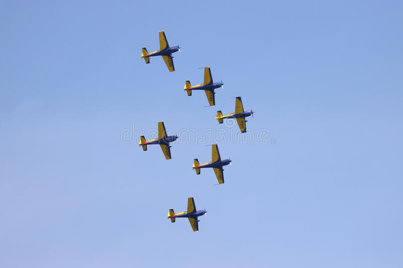 Airplanes performing acrobatic flight on blue sky stock photos
