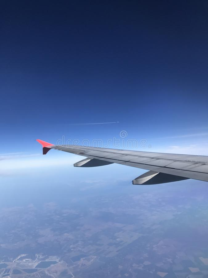 Airplanes racing. Airplane racing in blue sky royalty free stock photography
