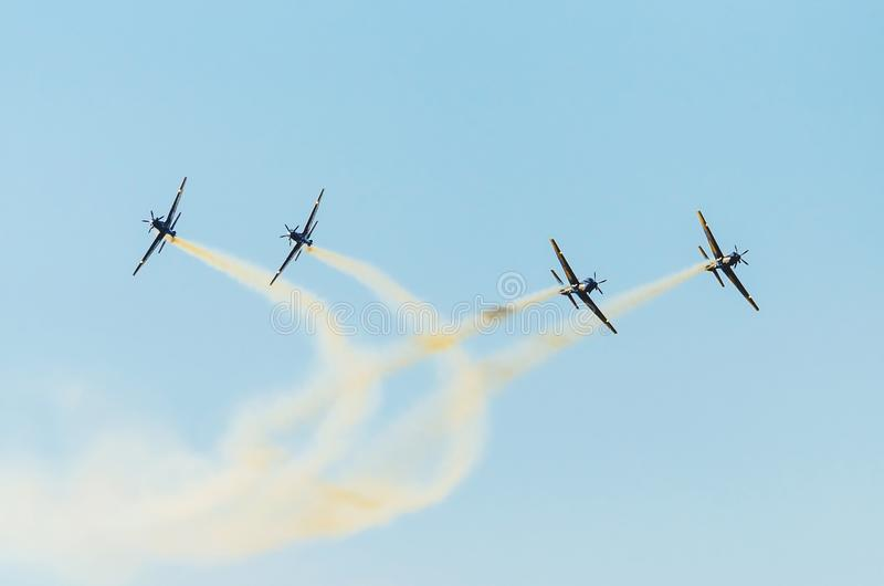 Airplanes separating into couples on a acrobatic maneuver stock photo