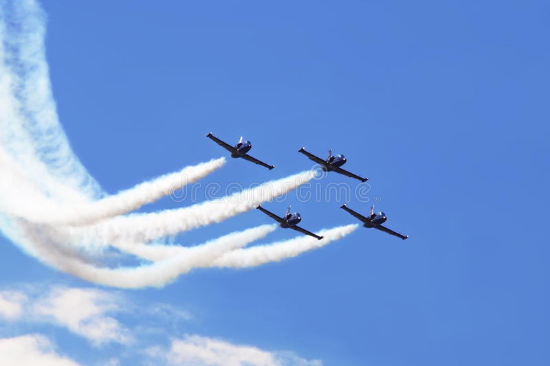Airplanes with smoke trails royalty free stock photography