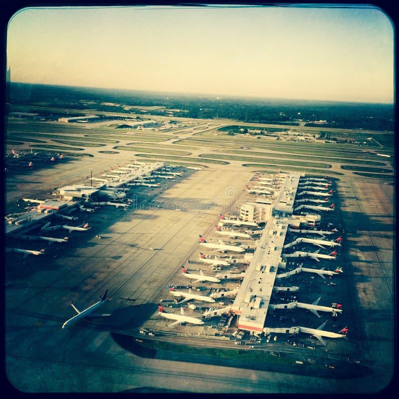 Airplanes at terminal, Atlanta, Georgia. Aerial view of planes parked at terminal at Atlanta, Georgia airport stock photos
