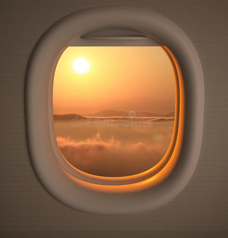 Airplanes window seat view. With sunset/sunrise stock photos