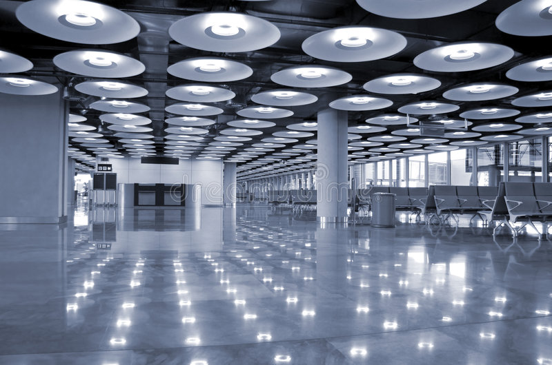 Airport. Blue interior perspective of airport in Madrid, Spain stock image