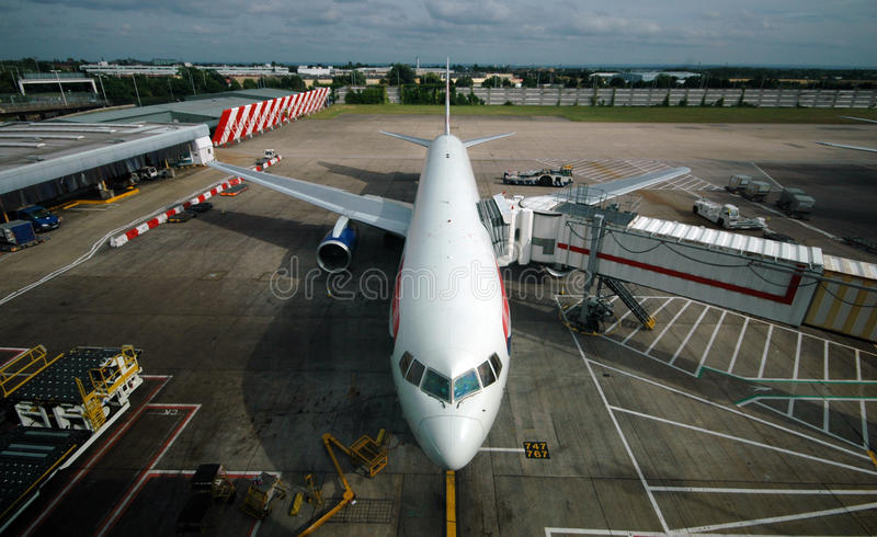 Airport. Aeroplane parked at airport terminal building stock photography