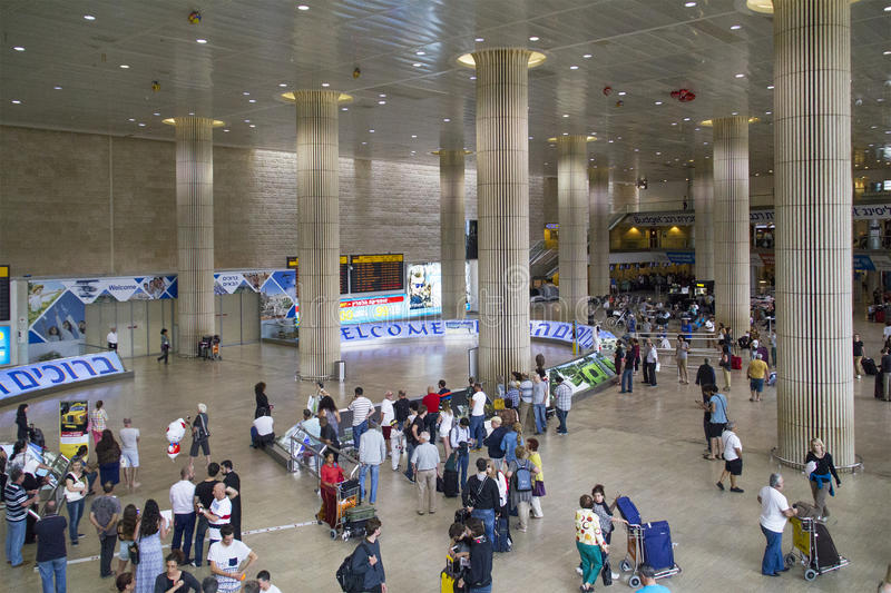 Passengers with luggage in groups in Ben Gurion Airport